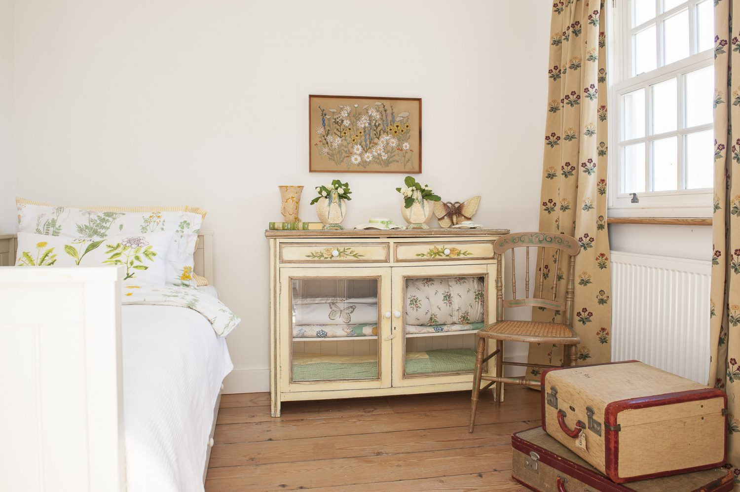 The primrose yellow guest bedroom at the front of the house