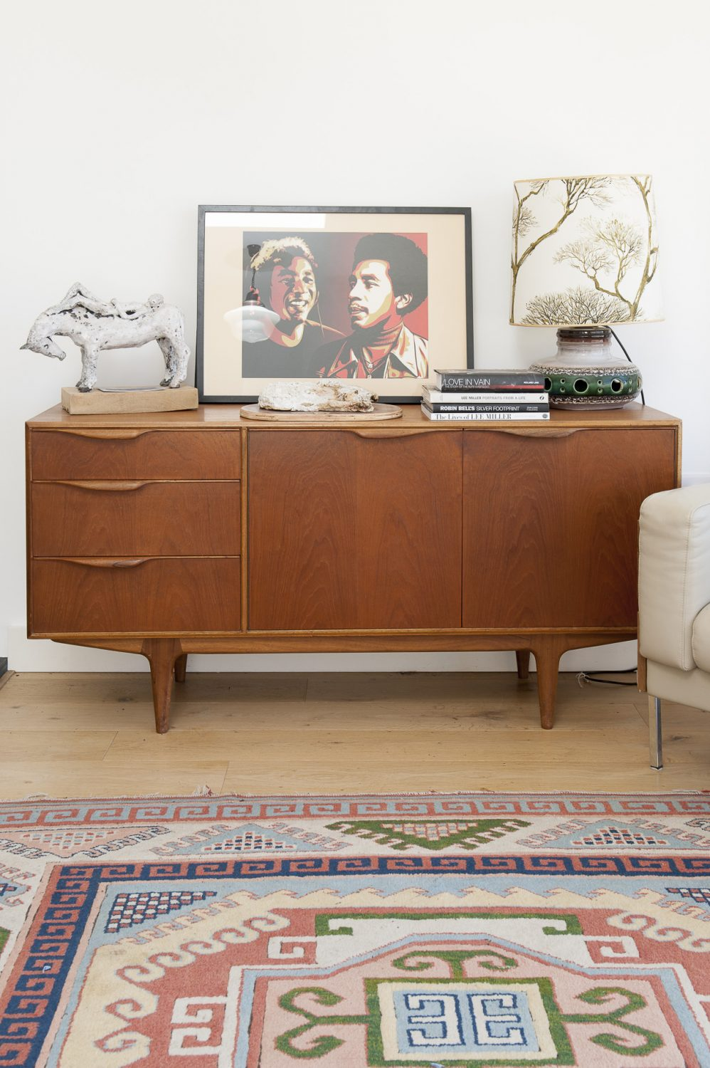 The 'new' room has a distinctly 70s feel, with McIntosh sideboard and lamps and Robin Day sofas