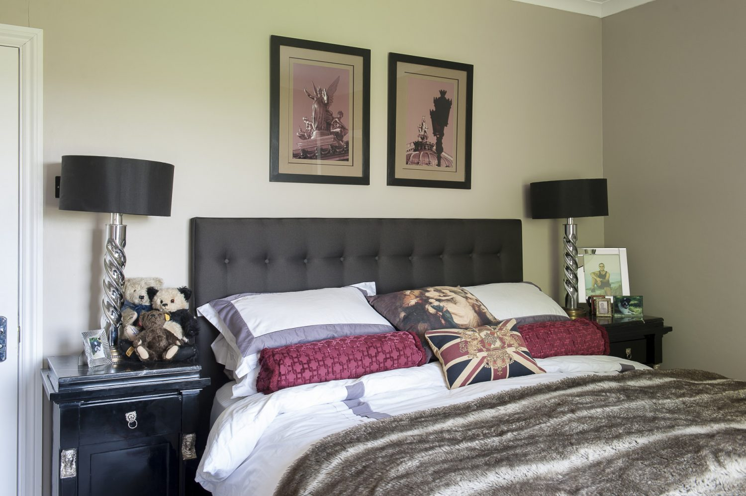 Black and white photographic prints in the master bedroom were taken by an official photographer to the French government