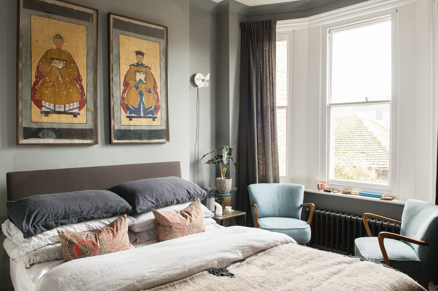 The master bedroom. James found the original Chinese scrolls on parchment on a business trip to Hong Kong and framed them in Hastings