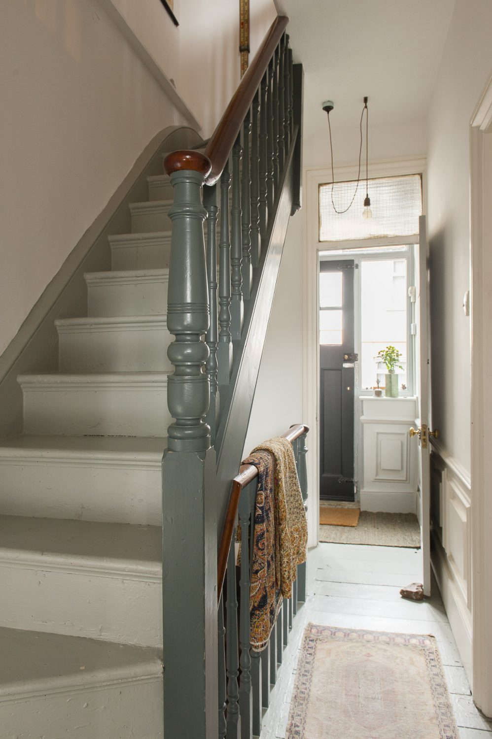 The staircase that winds up through the house is used to display more of the couple's finds