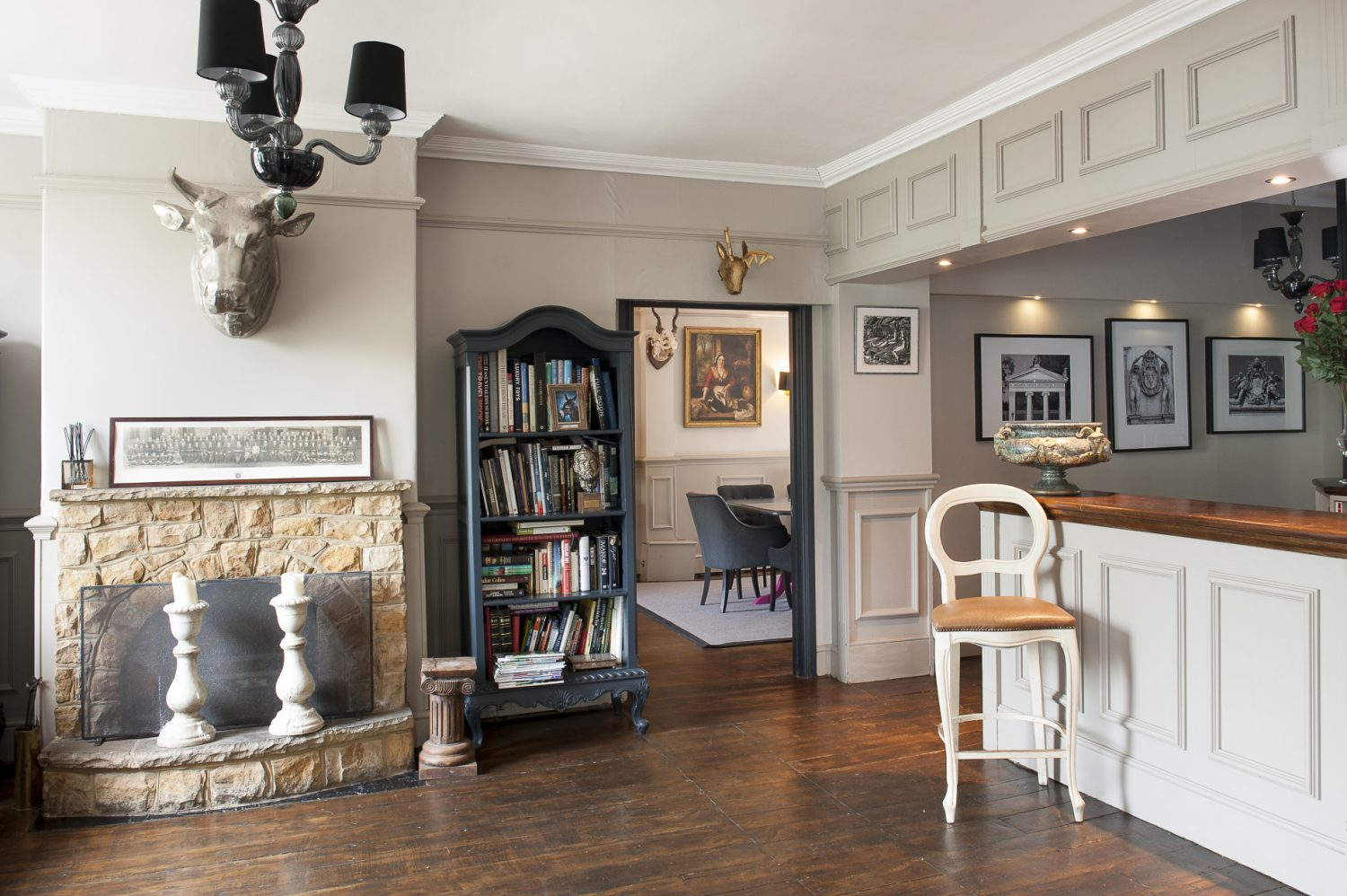 The entrance hall still contains an impressive timber-topped bar – perfect for when the couple are entertaining