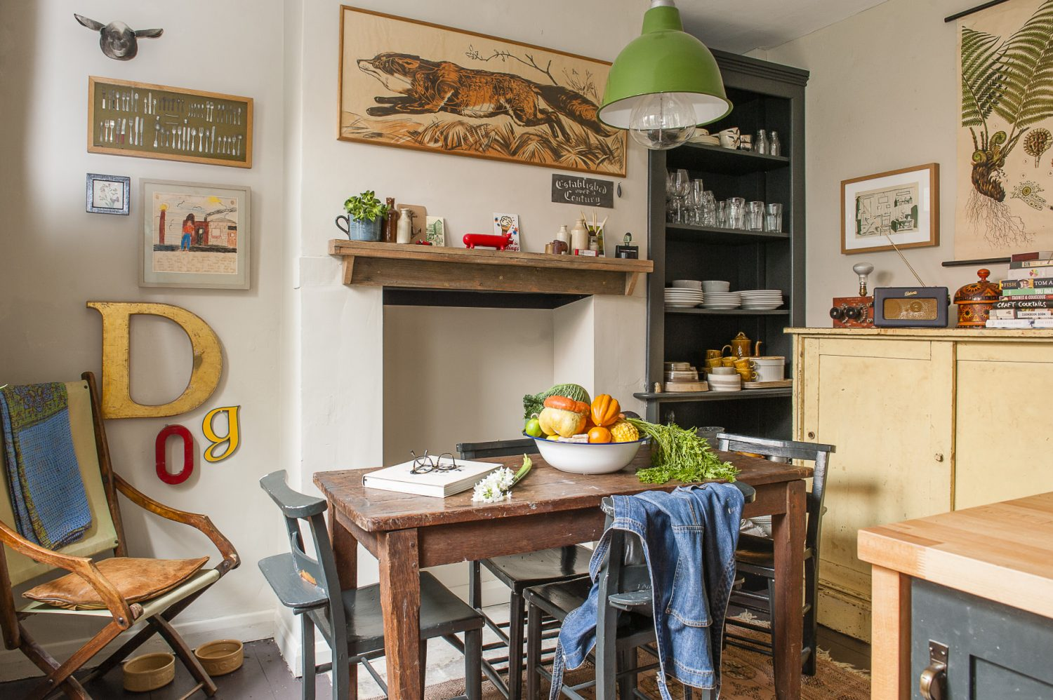 David and James used local carpenter Sam White to rebuild the kitchen. Stewart Walton, a craftsman who creates things out of Hastings Old Pier wood was commissioned to make the mantelpiece and shelving. David found the fox painting over the fireplace in a junk shop in Prague