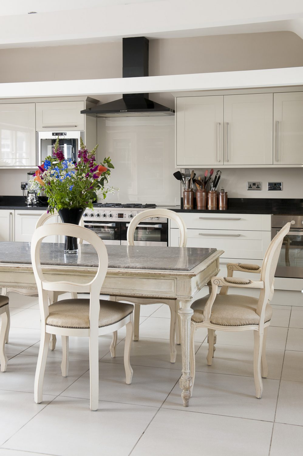 The spacious kitchen, which was once the pub kitchen, has been completely stripped out and refitted with a chic, grey Howdens kitchen and a distressed, marble-topped table