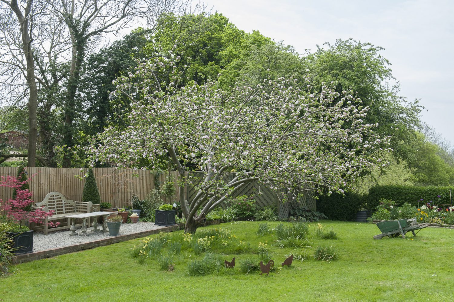 The sheltered back garden, where Simon – who is a keen gardener – spends much of his time, looks out over the quintessential High Weald landscape
