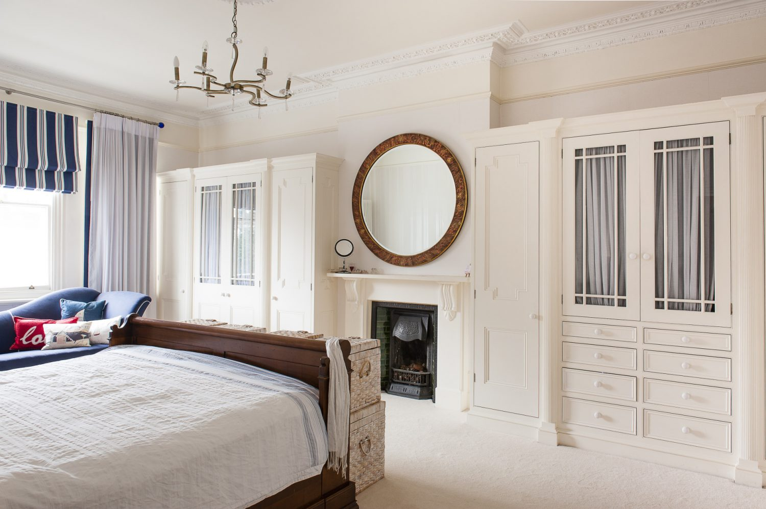 The master bedroom and en suite are cool, calm spaces punctuated by nautical stripes and the metallic flash of handmade mirrors by Joseph McCarthy