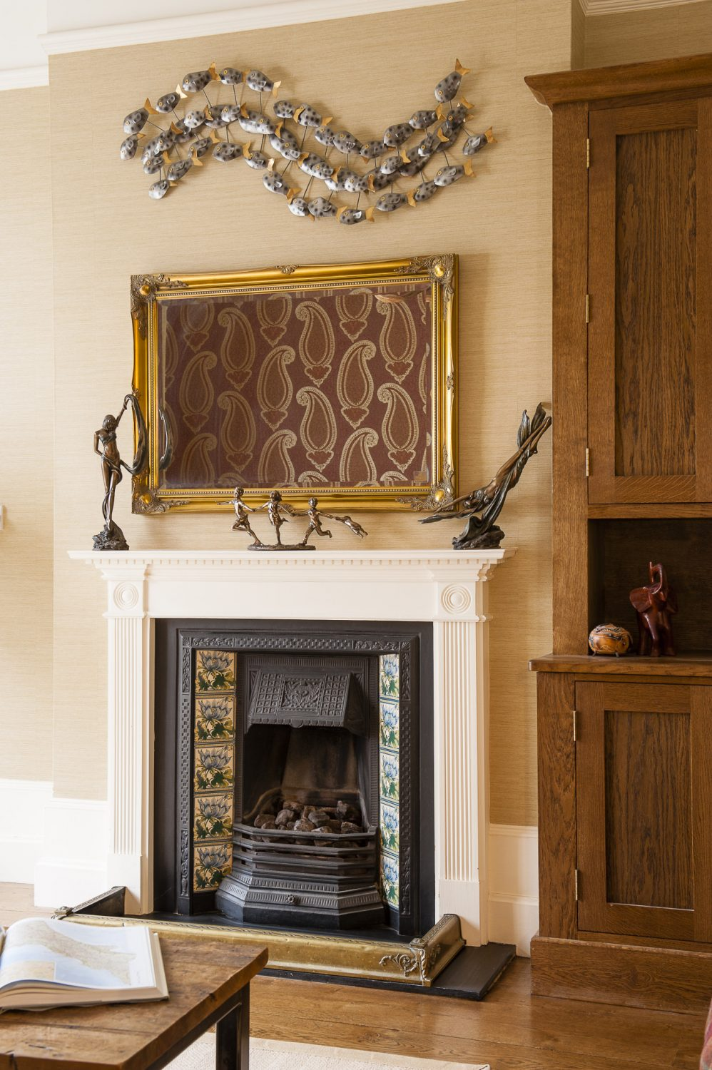 The back room is understated, calm and has quite a masculine feel incorporating comfortable leather sofas and an antler chandelier