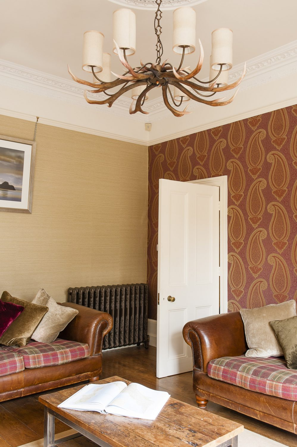 The back room is understated, calm and has quite a masculine feel. There are comfortable leather sofas with tartan cushions, and an open fire