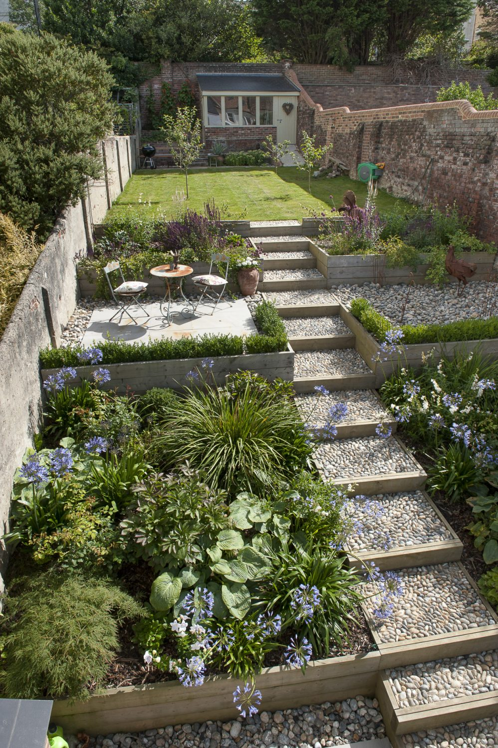 Rounded pebbles have been cemented into place on the wide steps that ascend to the back garden