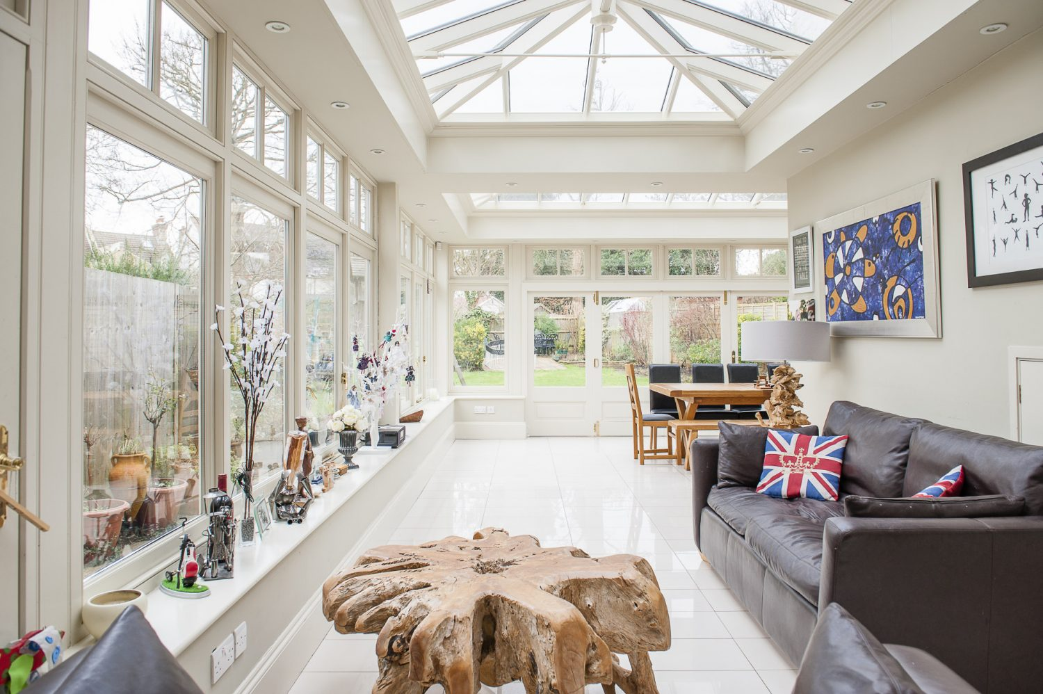 The spacious family kitchen leads into a bright conservatory – the newest addition to the house – which provides the perfect space for Jenny to run her workshops