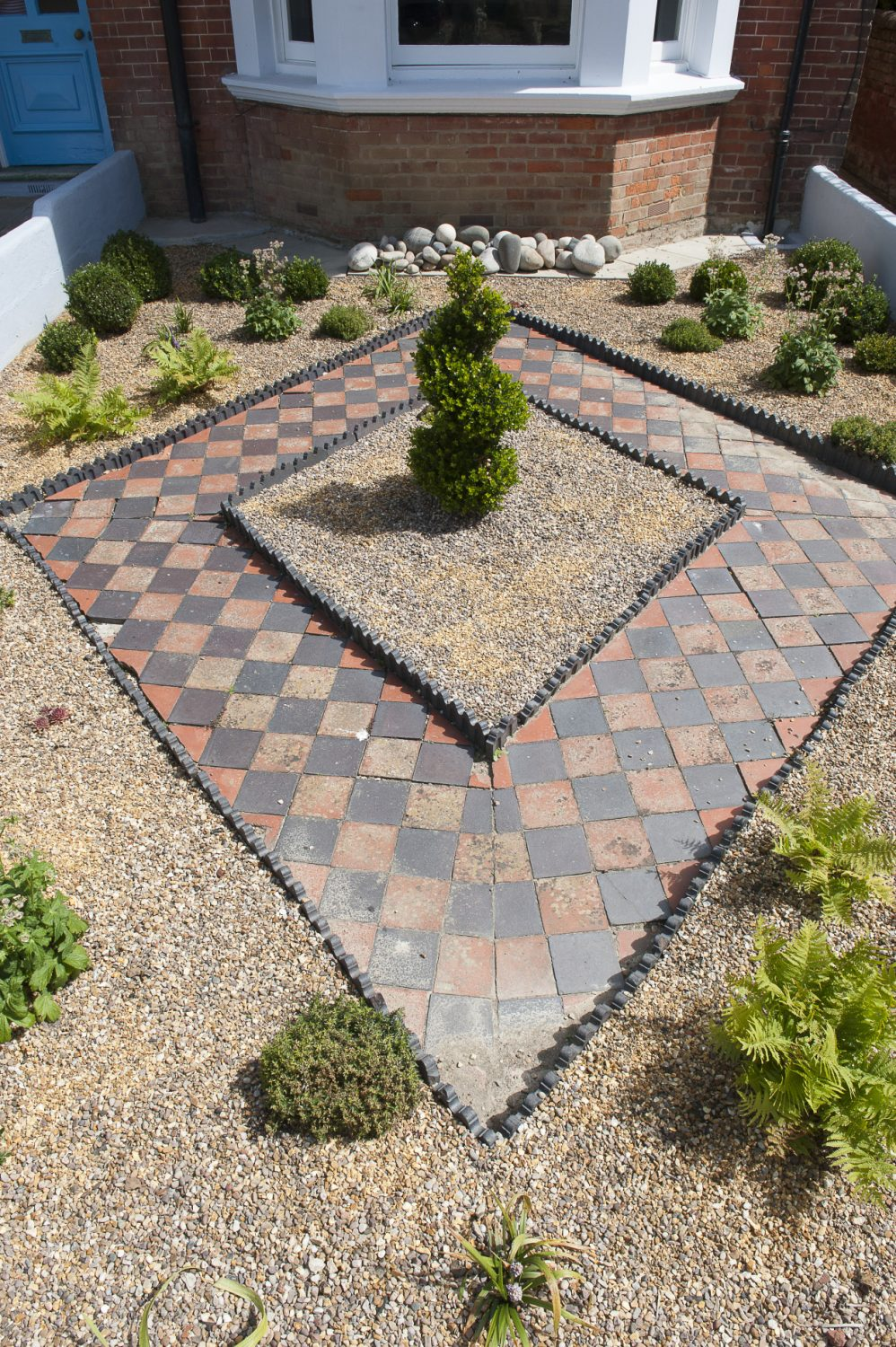 Annette has created a symmetrically stylish front garden to welcome visitors to her home