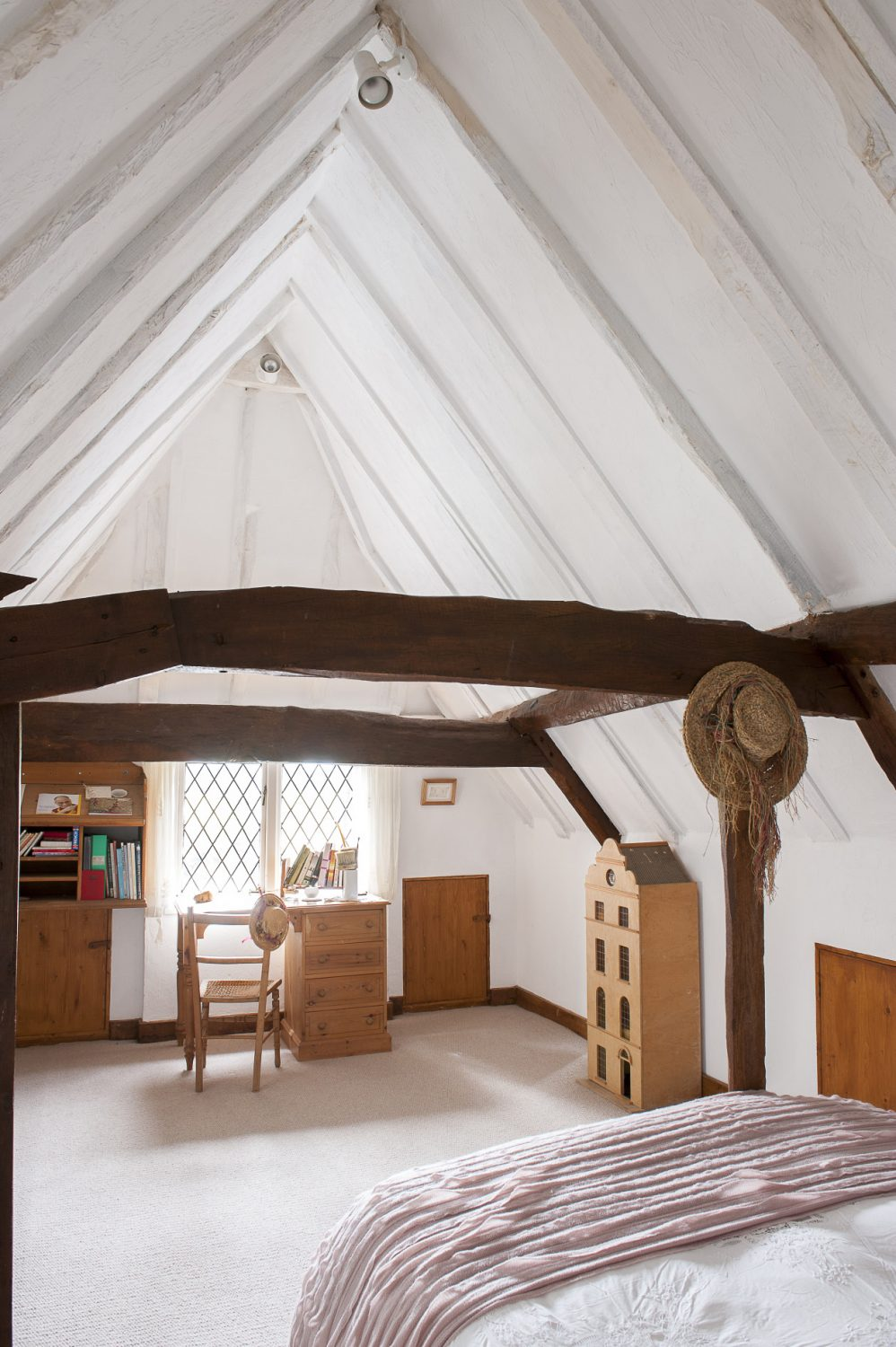 Two of the children's beamed bedrooms