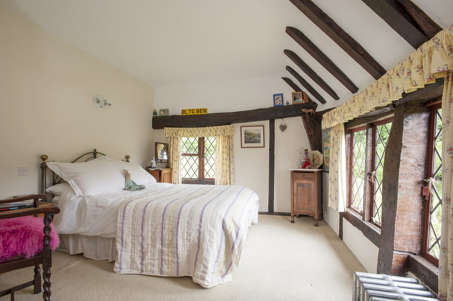There are two other bedrooms on this floor, all adorable with whitewashed walls and beams, brass beds and vintage bedspreads creating a warren of cosy bolt holes for their now grown-up offspring and visitors alike