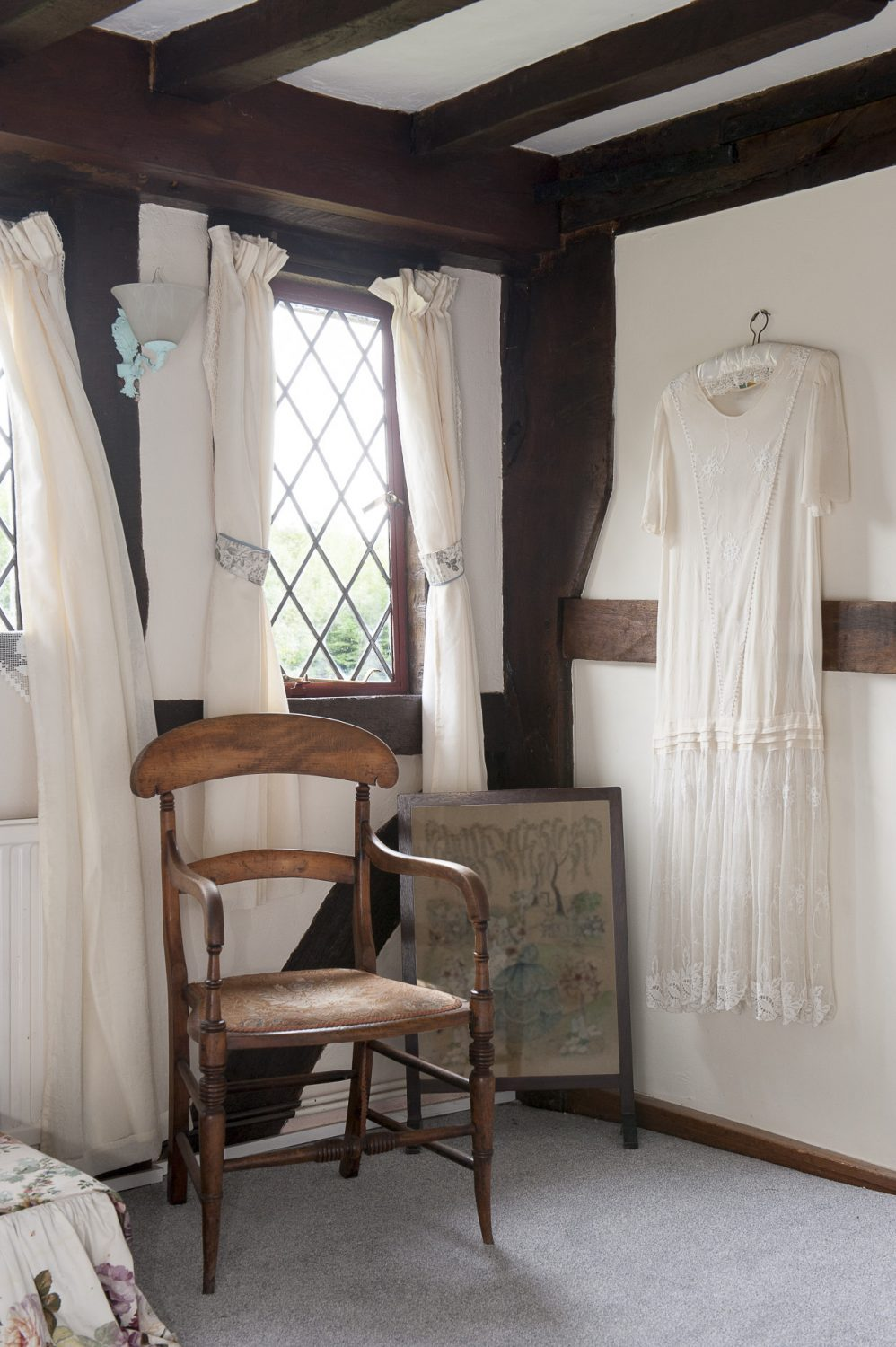 Simple linen mushroom coloured curtains look fabulous and with big windows to the east the bedroom gets bathed in morning sunshine