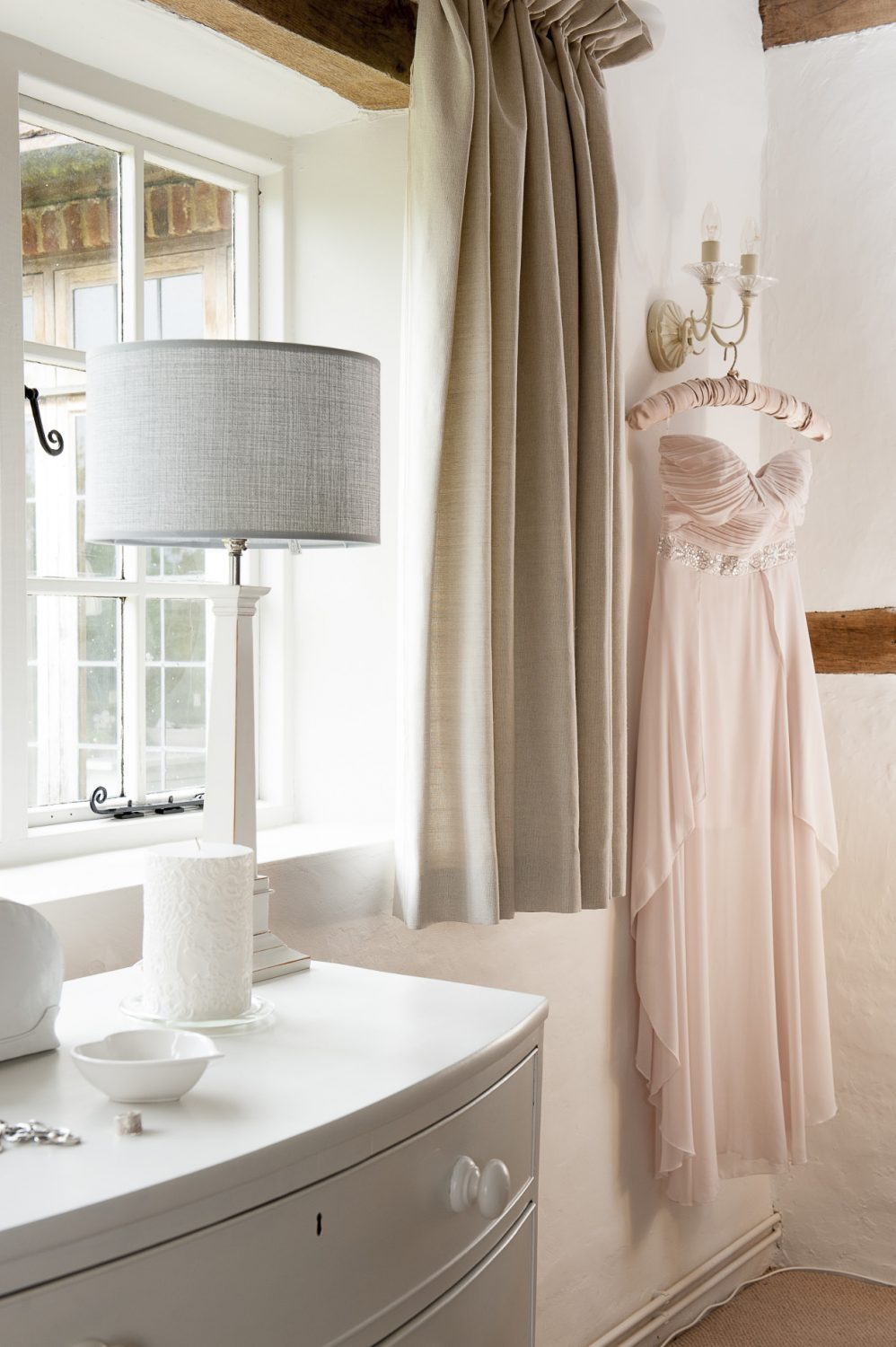 Décor in the bedroom has been kept, pale, pretty and feminine – whilst steering clear of twee country styling
