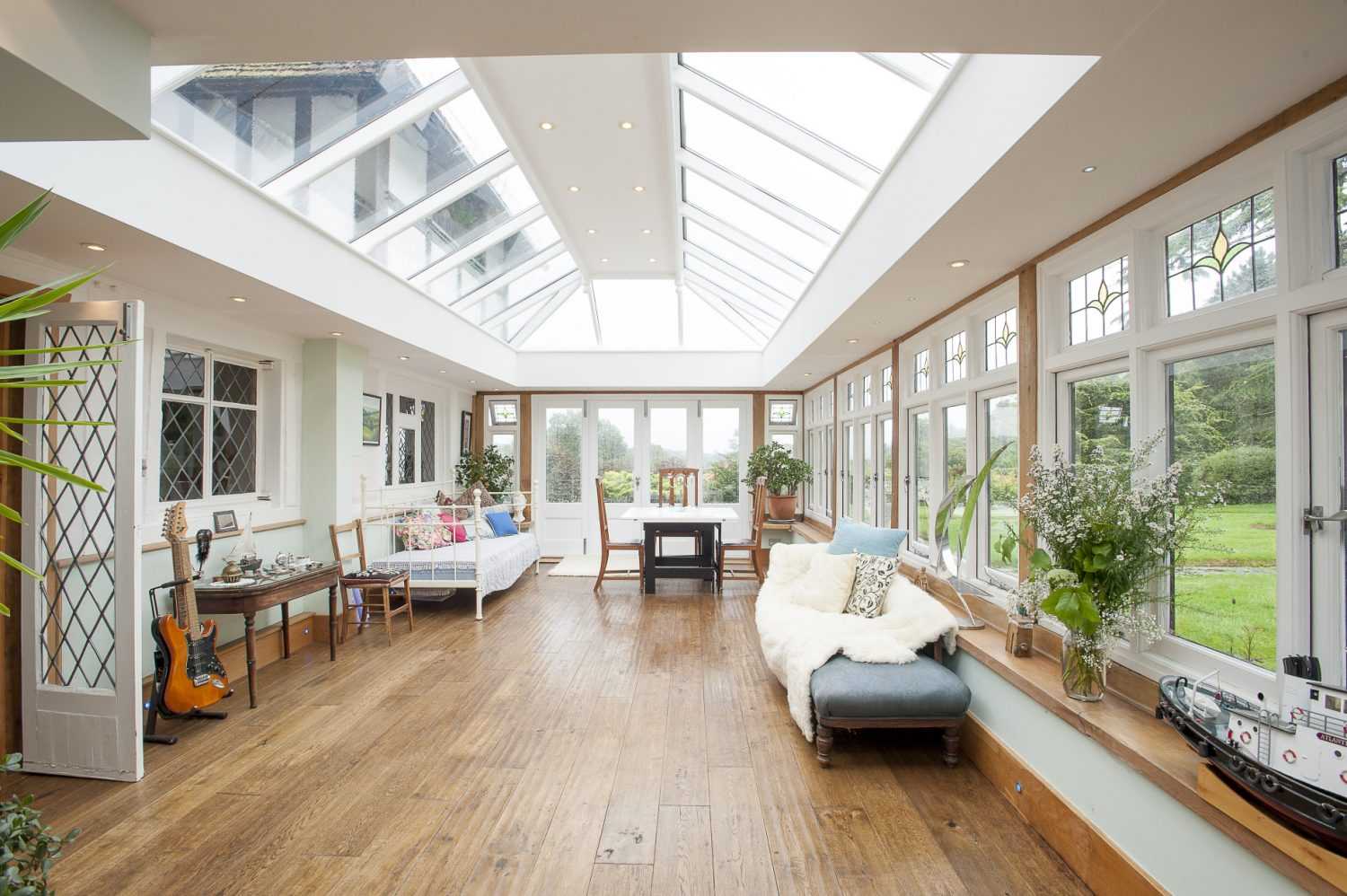 The Garden Room is where Jilly and Peter spend a great deal of their time. With underfloor heating and a southwest aspect it's a warm and cosy place to soak up the winter sunshine