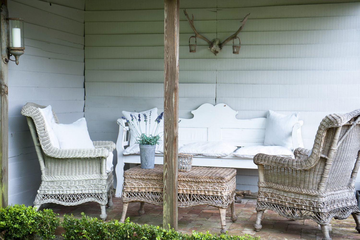 A sheltered corner makes the perfect indoor-outdoor space in which to relax in summer