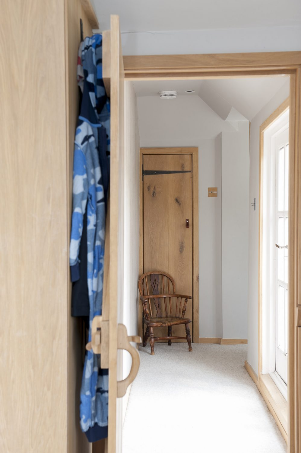 The landing to Oli's bedoom, over the extended kitchen-dining area, includes a door on to the roof terrace. Plush, neutral carpets throughout make the house feel extremely snug