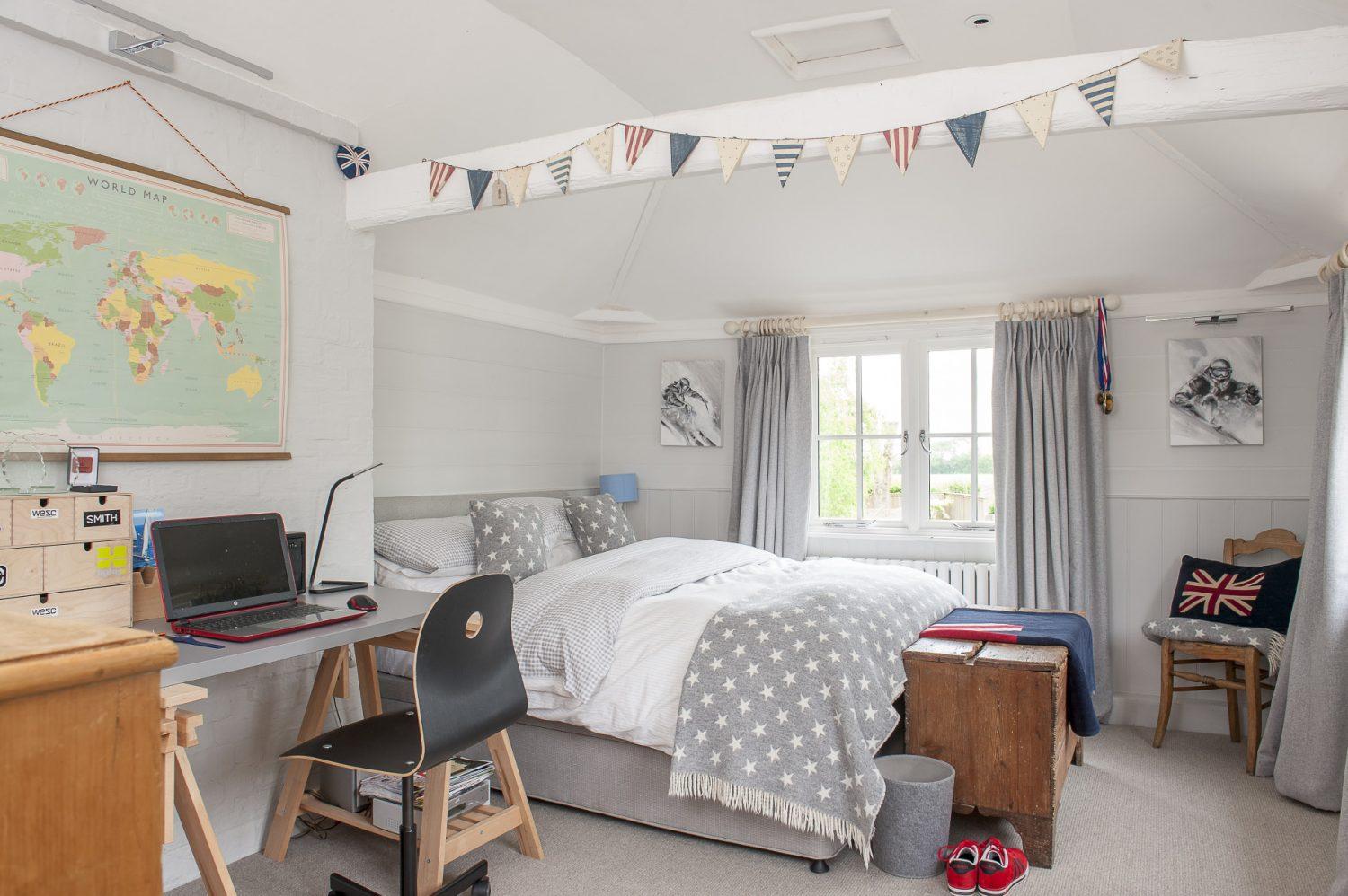 The boys' rooms are light and airy and cleverly furnished to allow work, rest and play – with typical, smart wooden furnishing including these sturdy bunk beds in Oli's room