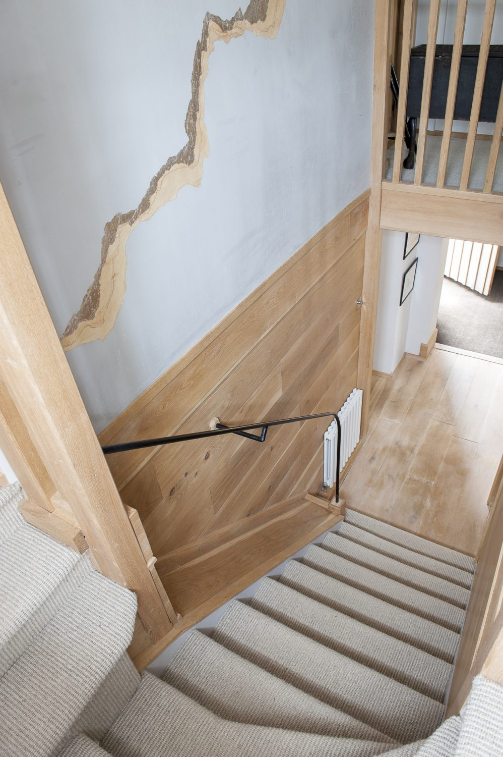 The staircase is far from what one might expect in a country cottage