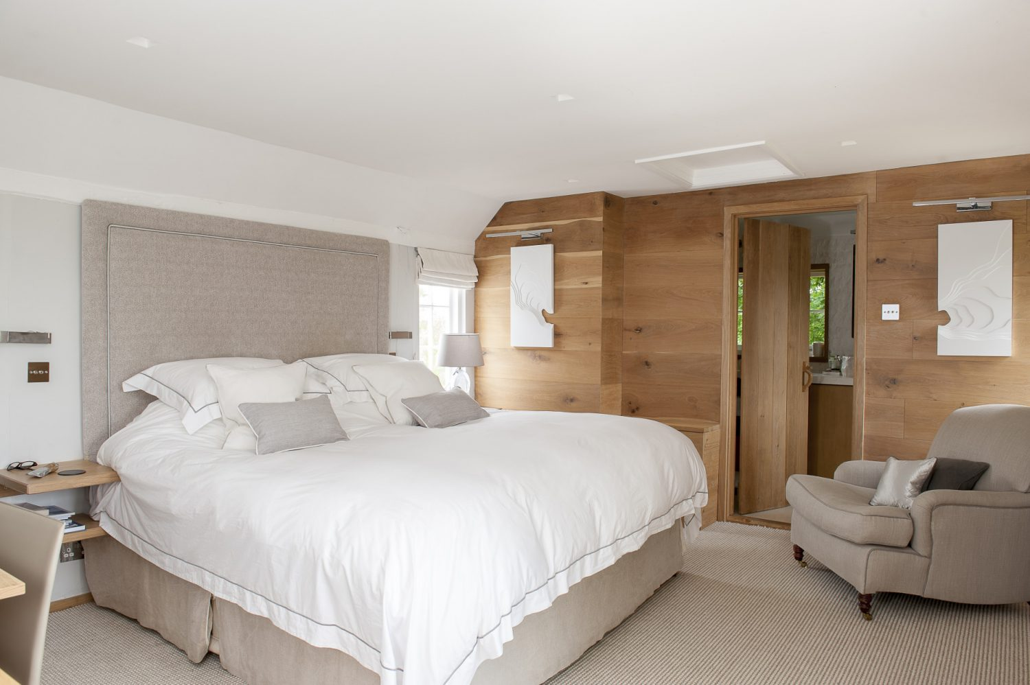 The main bedroom is an oasis of calm and order – helped by muted colours and the addition of an en suite dressing room and hidden cupboards