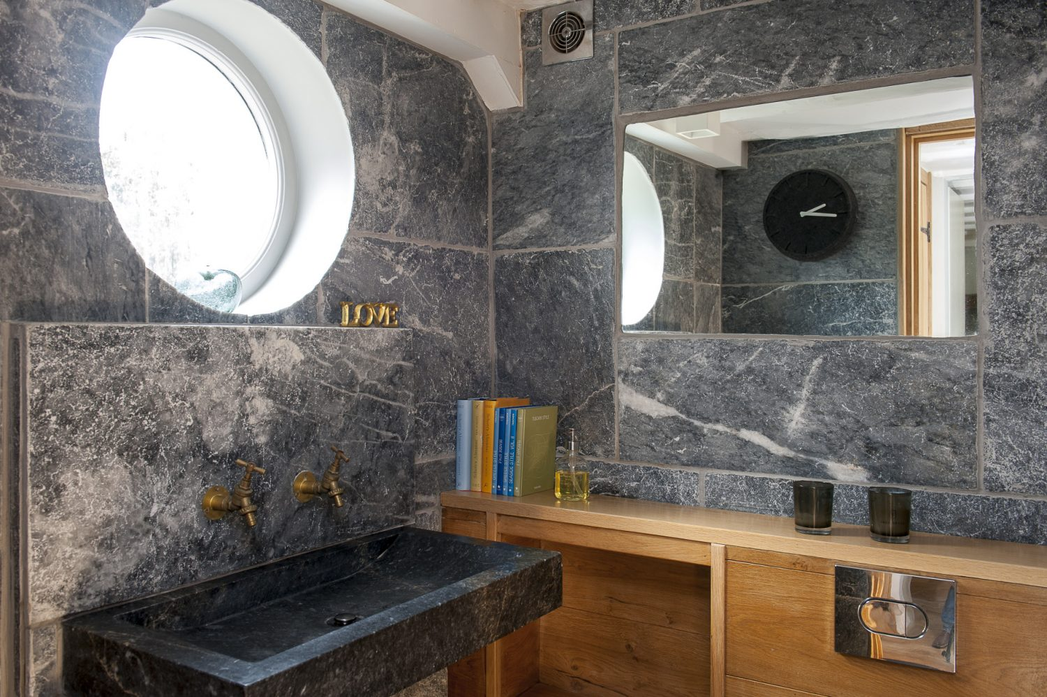 A luxurious, rather masculine downstairs loo area, designed by Andrew