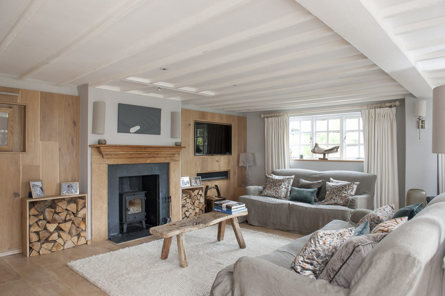 The contemporary wood panelling throughout Martine and Andrew's home gives it an undeniably cosy – and high class – chalet feel
