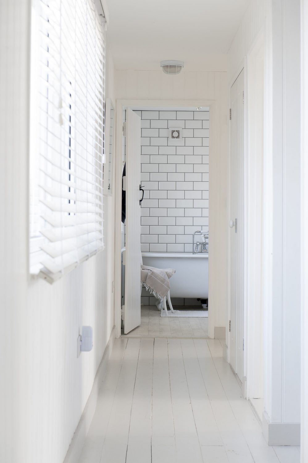 The floors throughout the house are painted in 'Ammonite' by Farrow and Ball. The simple floor treatment has proved to be a godsend too, as it is very easy to sweep out the main by product of seaside living – sand