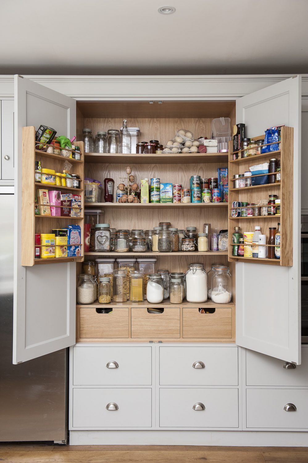 The immaculate larder is a shrine to organisation, with clearly labelled jars next to neat groupings of tins and everyday essentials
