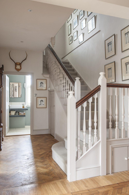 The hallway's herringbone parquet has been expertly restored