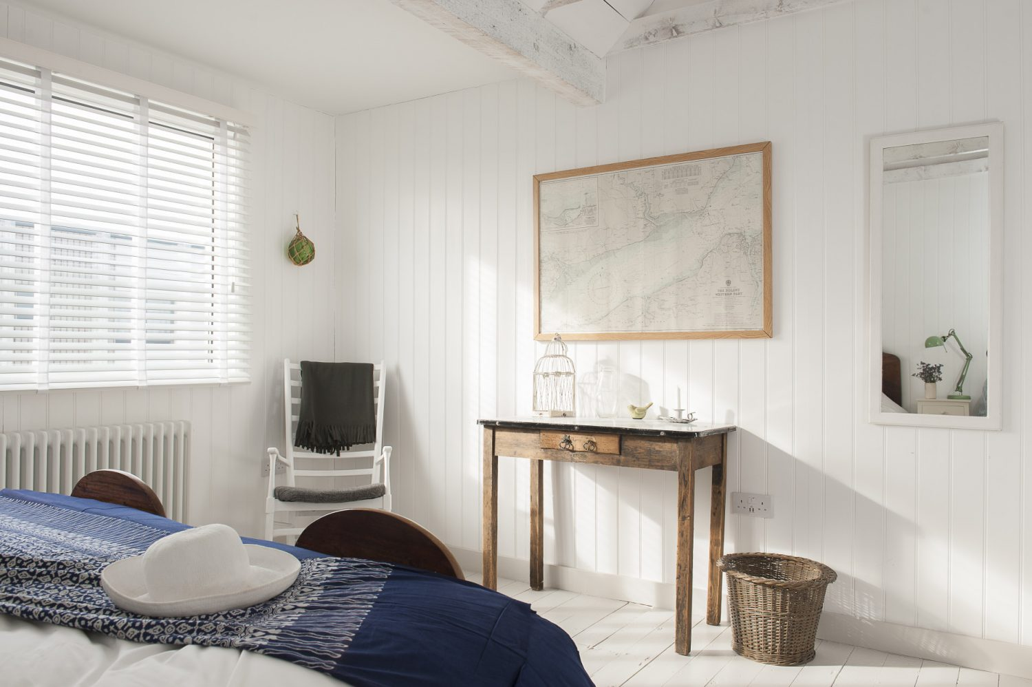 The bedrooms have been treated in a similar uncomplicated way and the understated scheme is a great backdrop to the quaint finds and harmonising colour accents