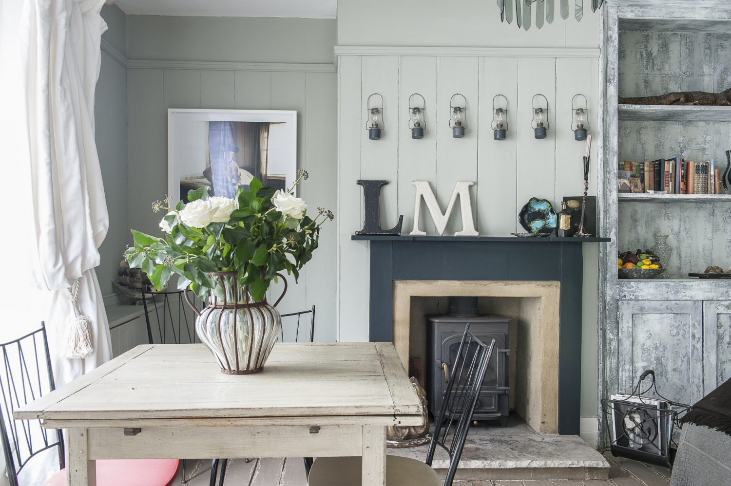 The panelled downstairs sitting room features fitted furniture with a mottled grey paint effect applied by Bill