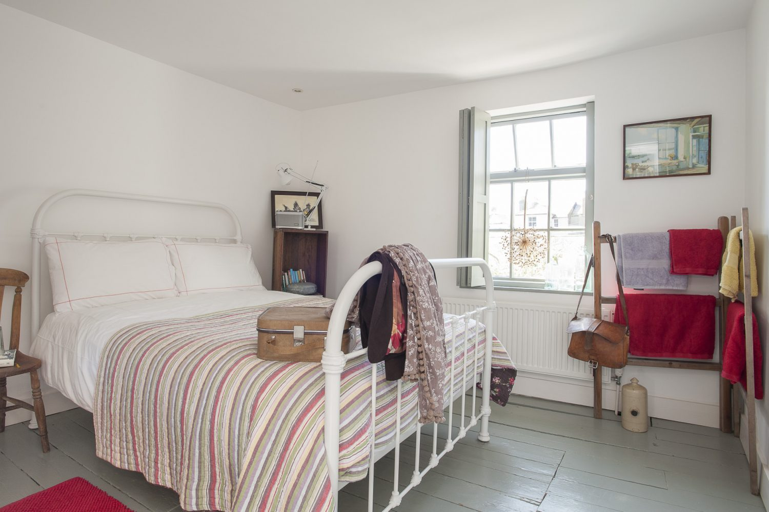 The two bedrooms are two more cool white and bright spaces, colour and warmth added by Linda's choice of lovely bedspreads