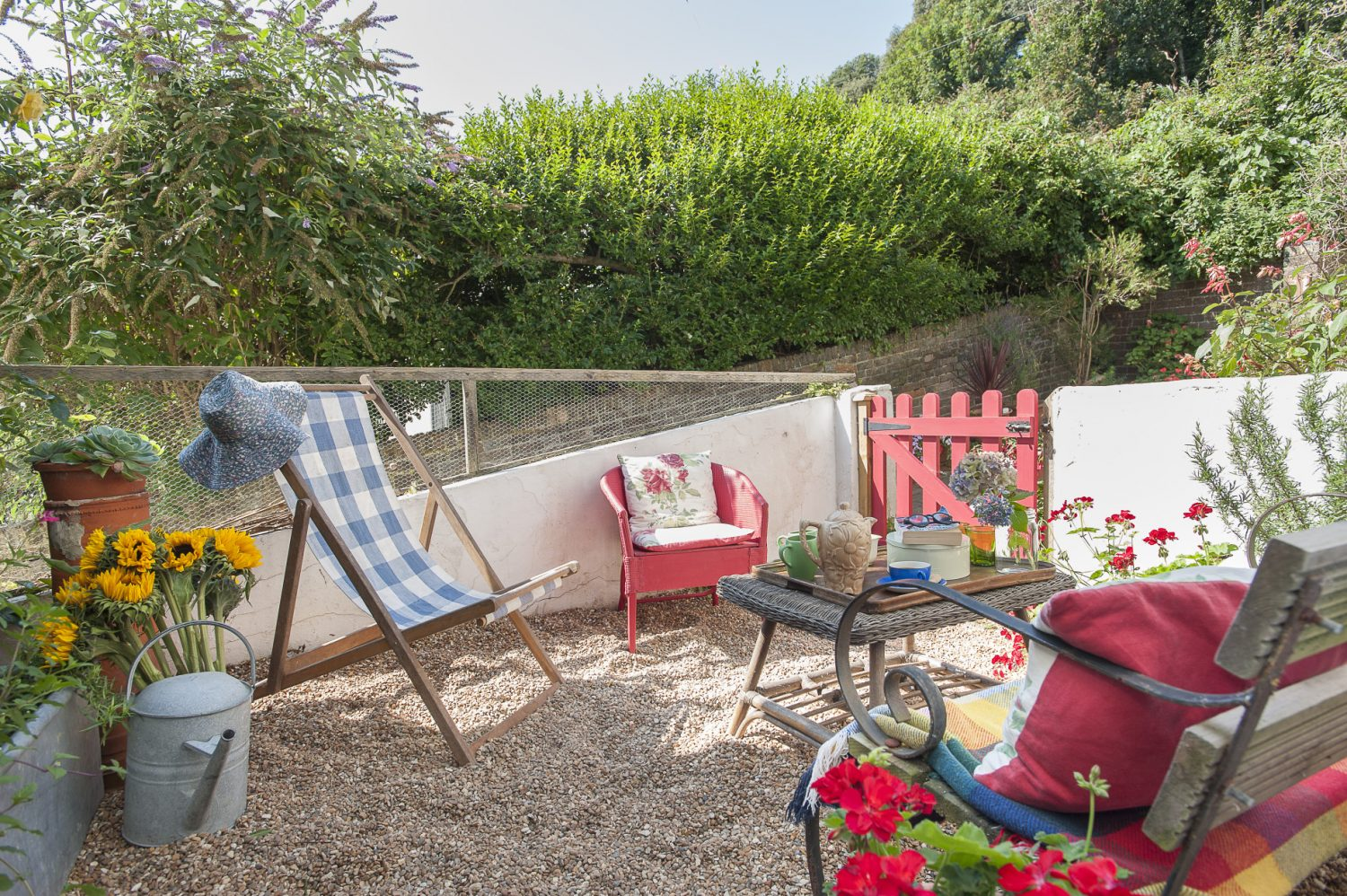 Linda's husband has transformed the small pebble garden at the front of the house into a lovely outdoor seating area which capitalises on the morning sunshine