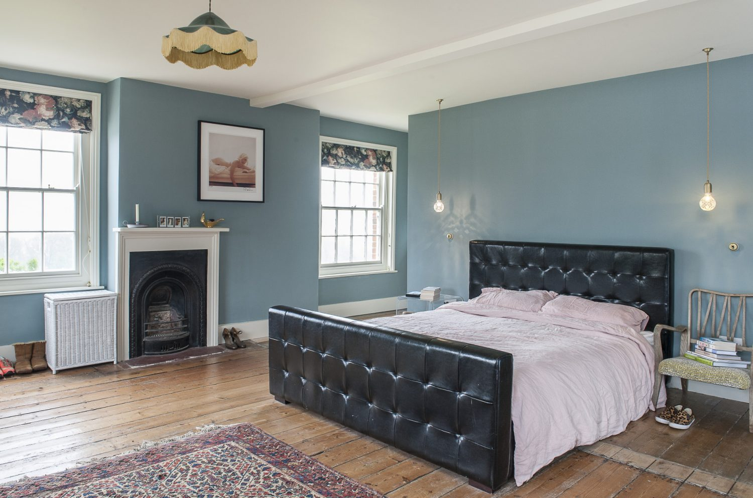 Sally and Rob created the double-aspect master bedroom and en suite from two original rooms. The walls are in F&B Oval Room Blue and the dark blue floral blinds are from House of Hackney. A limited edition print of Marilyn Monroe by Bert Stern and a delicate limited edition Tracey Emin line drawing of Kate Moss are hung on the walls