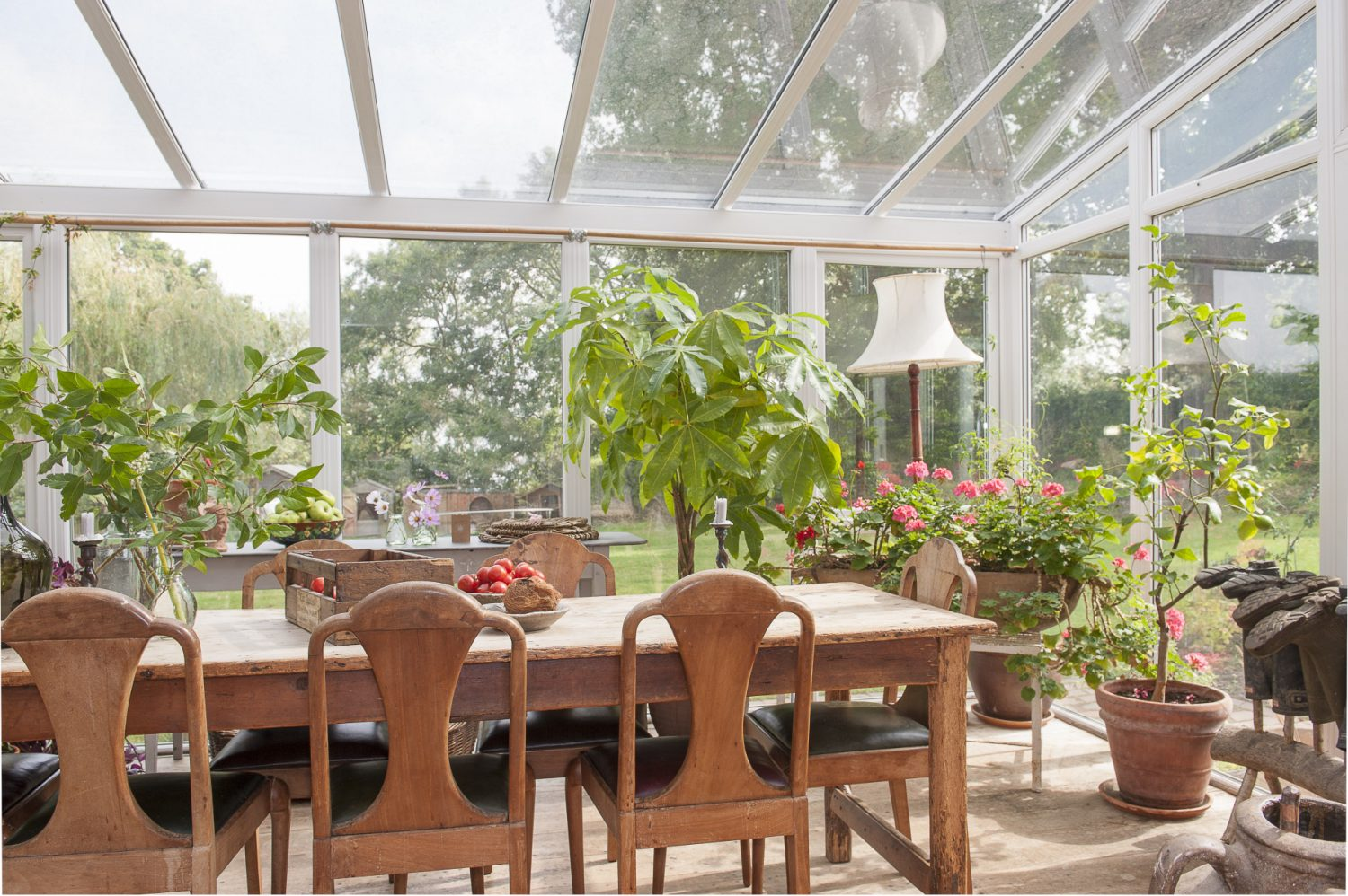The kitchen opens into the conservatory which looks out into the garden, with its rows of neat vegetable beds. Tina has brought a touch of the outside in, filling large terracotta pots, wooden trugs and troughs with geraniums, climbers and trees