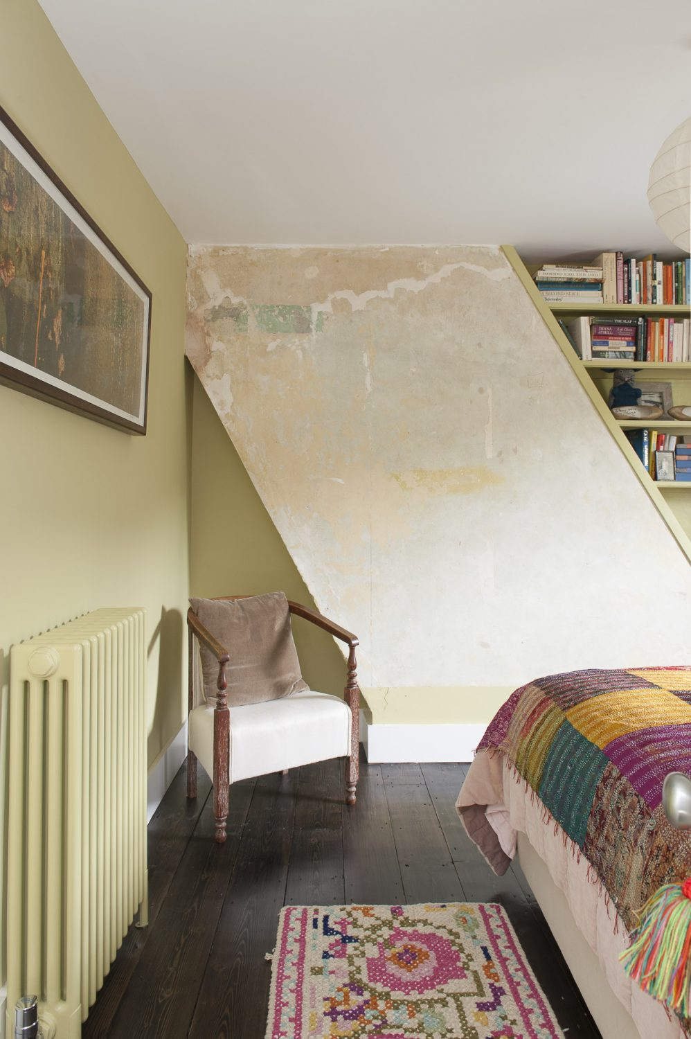 Ginny left the exposed paintwork on the chimney breast, as a feature - after finding when they stripped away many layers of paint, the exact green she had already chosen for the room underneath them all. The colour is Churlish Green by Farrow & Ball