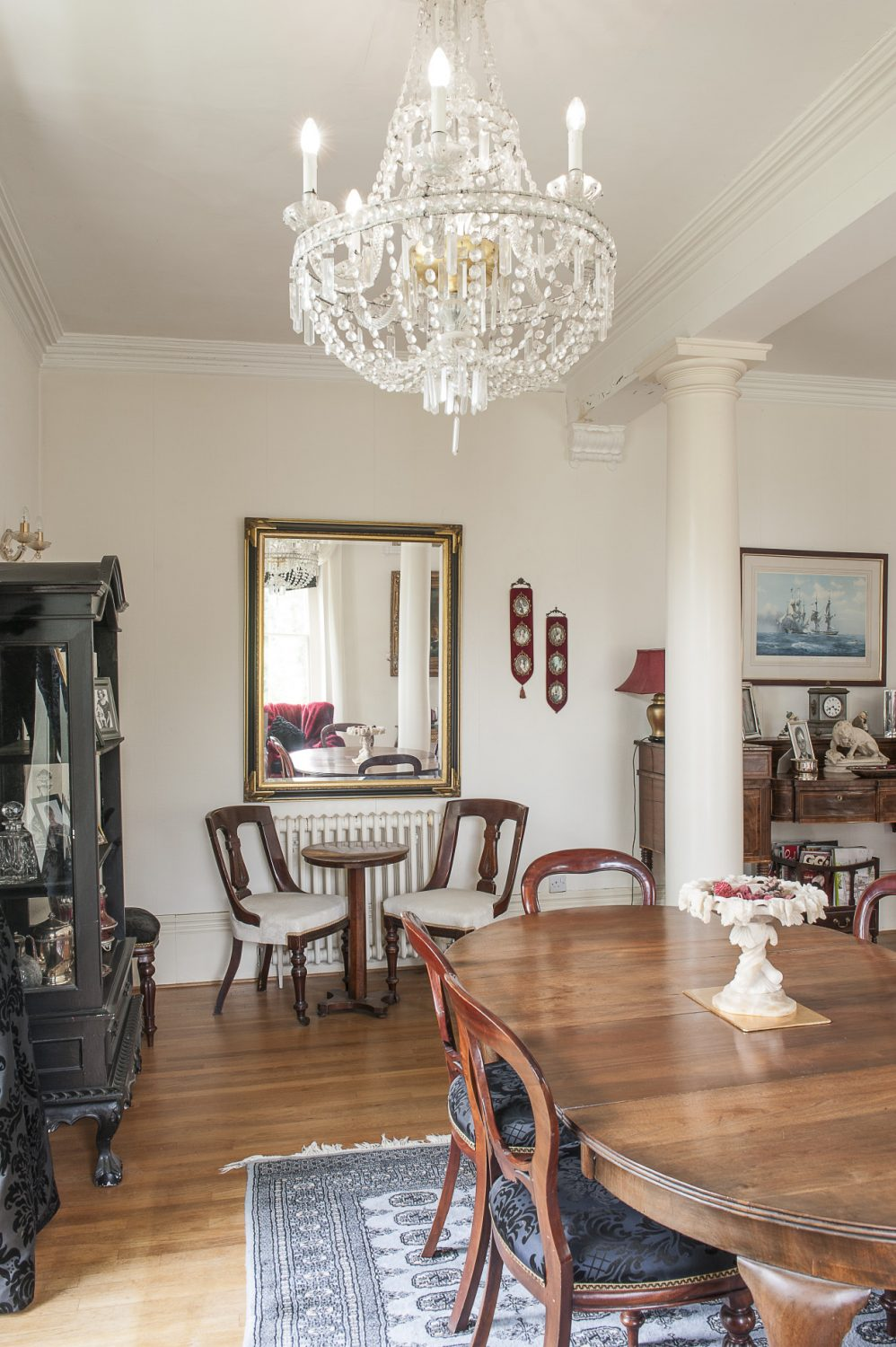 One third of the room now serves as a dining area, the table overhung by a huge Florentine chandelier