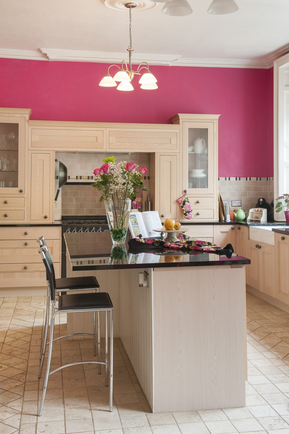 Dawn has lavished vibrant pink paint on the walls of her kitchen and kept the costs down by choosing units from B&Q. The polished black marble work surfaces add a luxurious finishing touch