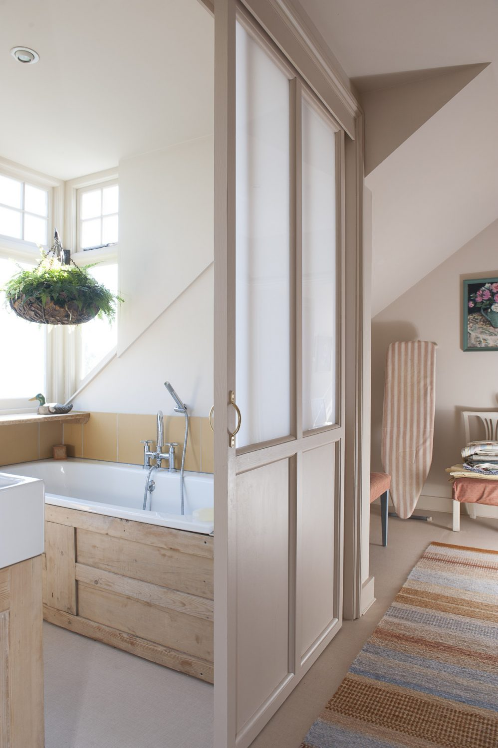 The dormer was added on to make room for a new bathroom – with a space-saving sliding door