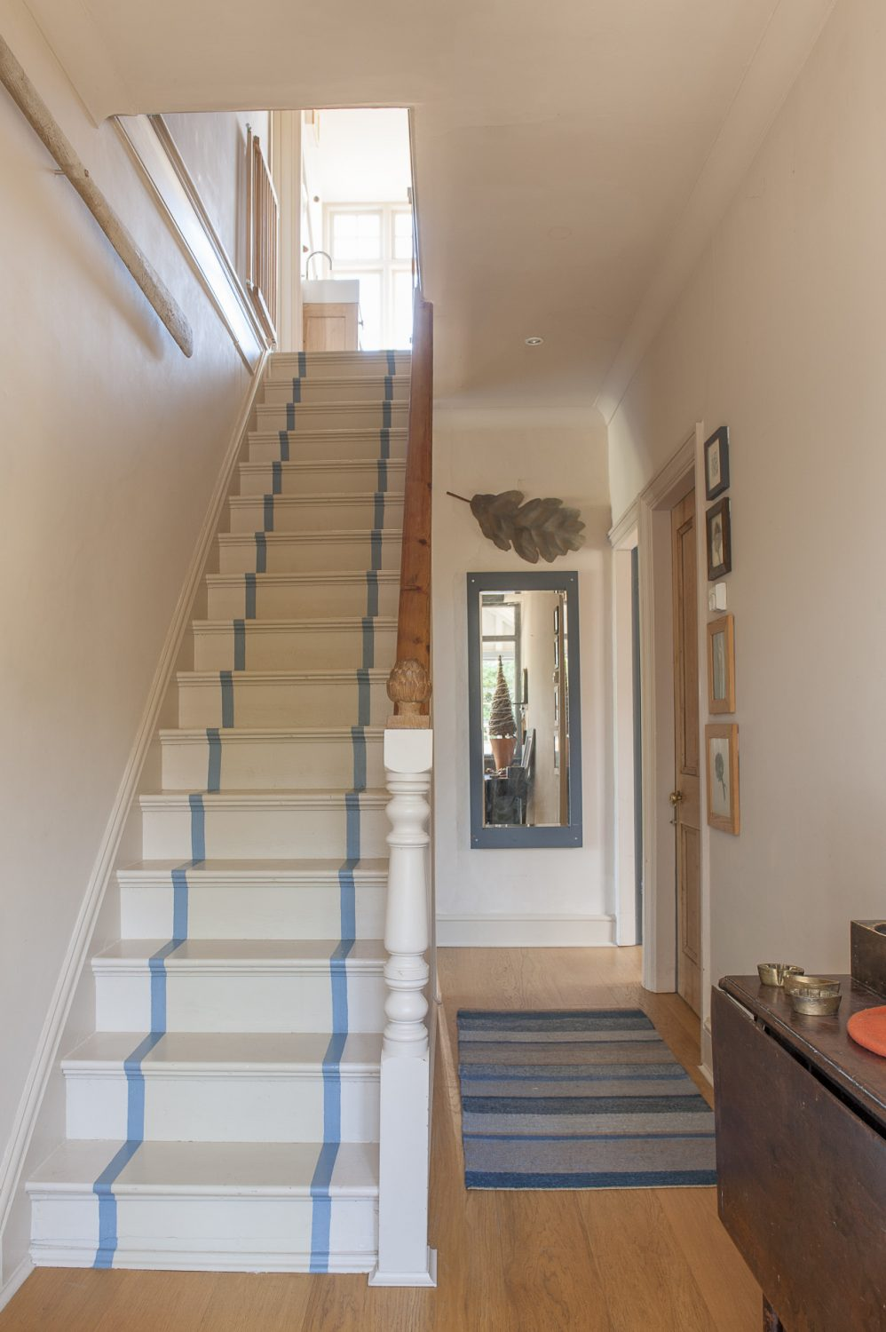 The stairs have been painted with non-slip paint, to give the effect of a carpet runner
