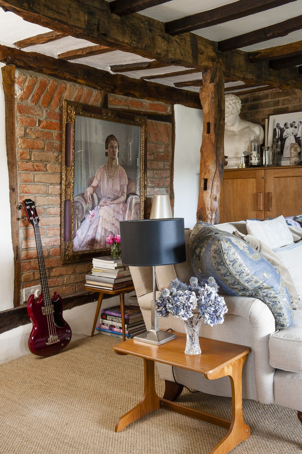 Roni's cottage is filled with lovely pieces of art which date from the 1920s through to the 1950s. Her favourite is a large formal 1936 portrait of an aristocratic lady in pink that virtually covers one of the sitting room walls that Roni bought from Roy Massingham in Westerham