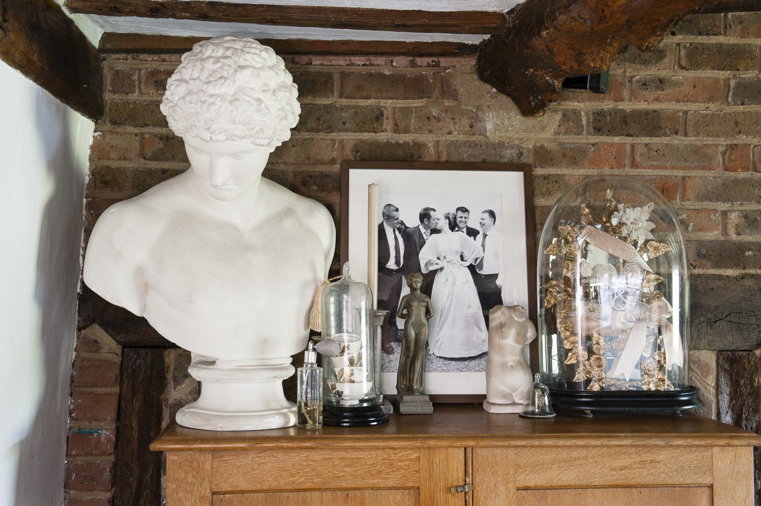The couples' own wedding photograph sits amid other special items