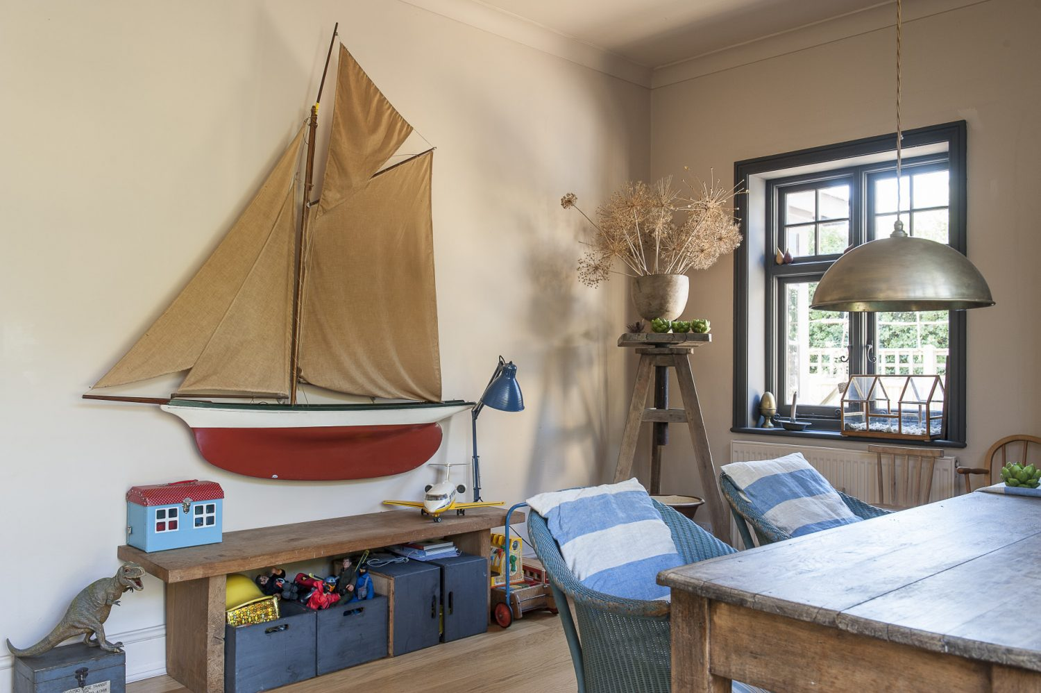 A toy-filled corner includes a model boat which Francine bought for her husband, when they got married, from a shop in Peckham
