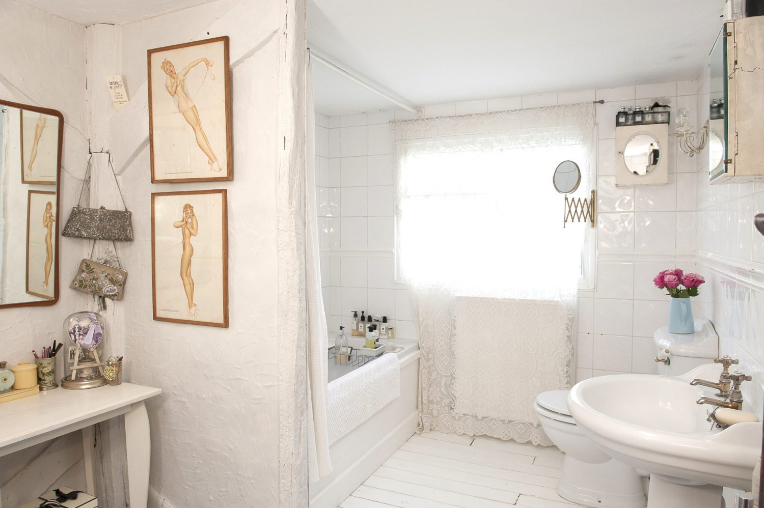 Across the corridor from the master bedroom, the all-white bathroom, filled with Jo Malone goodies, is a serene and inviting space in which to relax after a long day at work