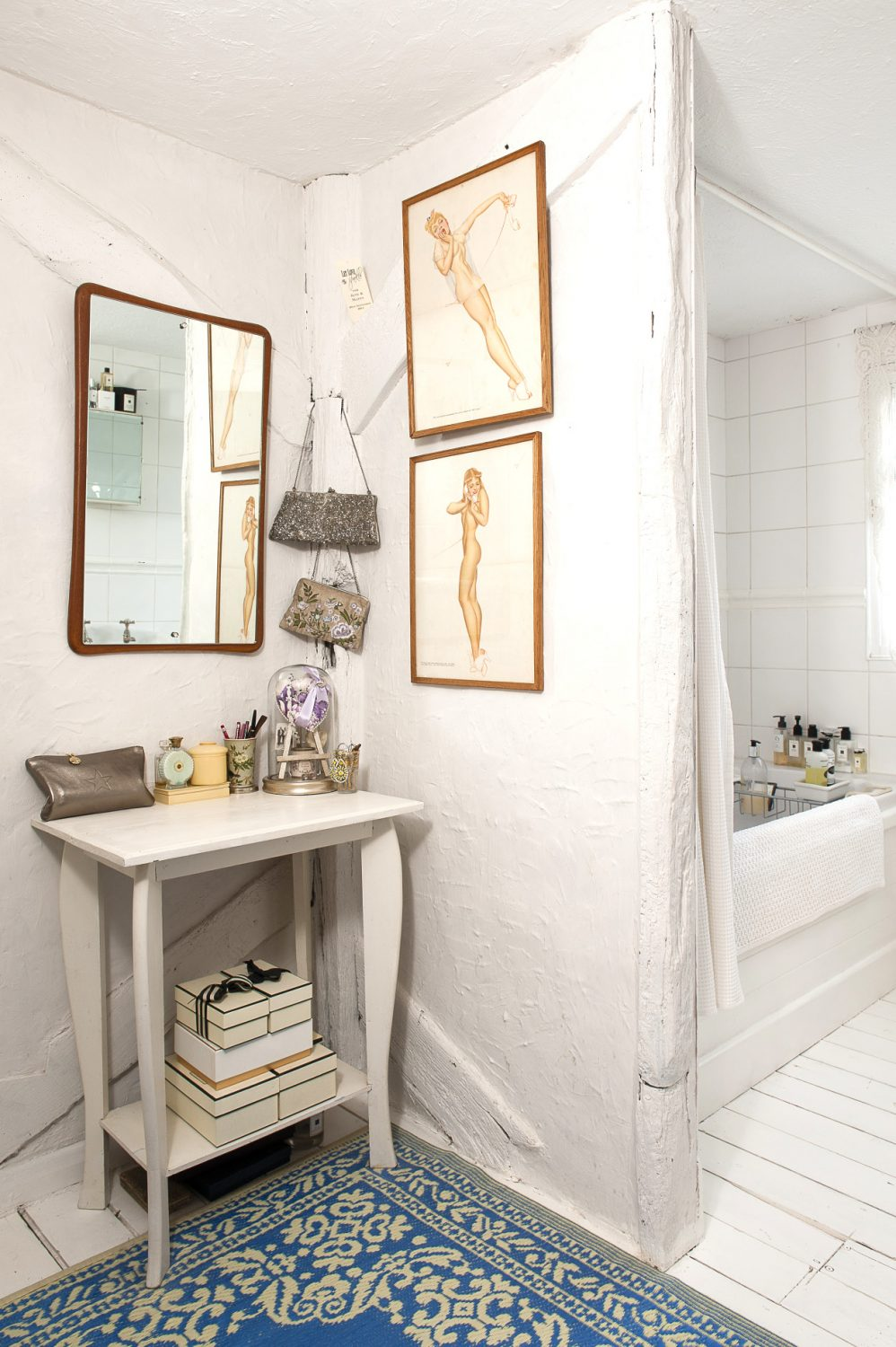 The pretty bathroom is home to more artwork
