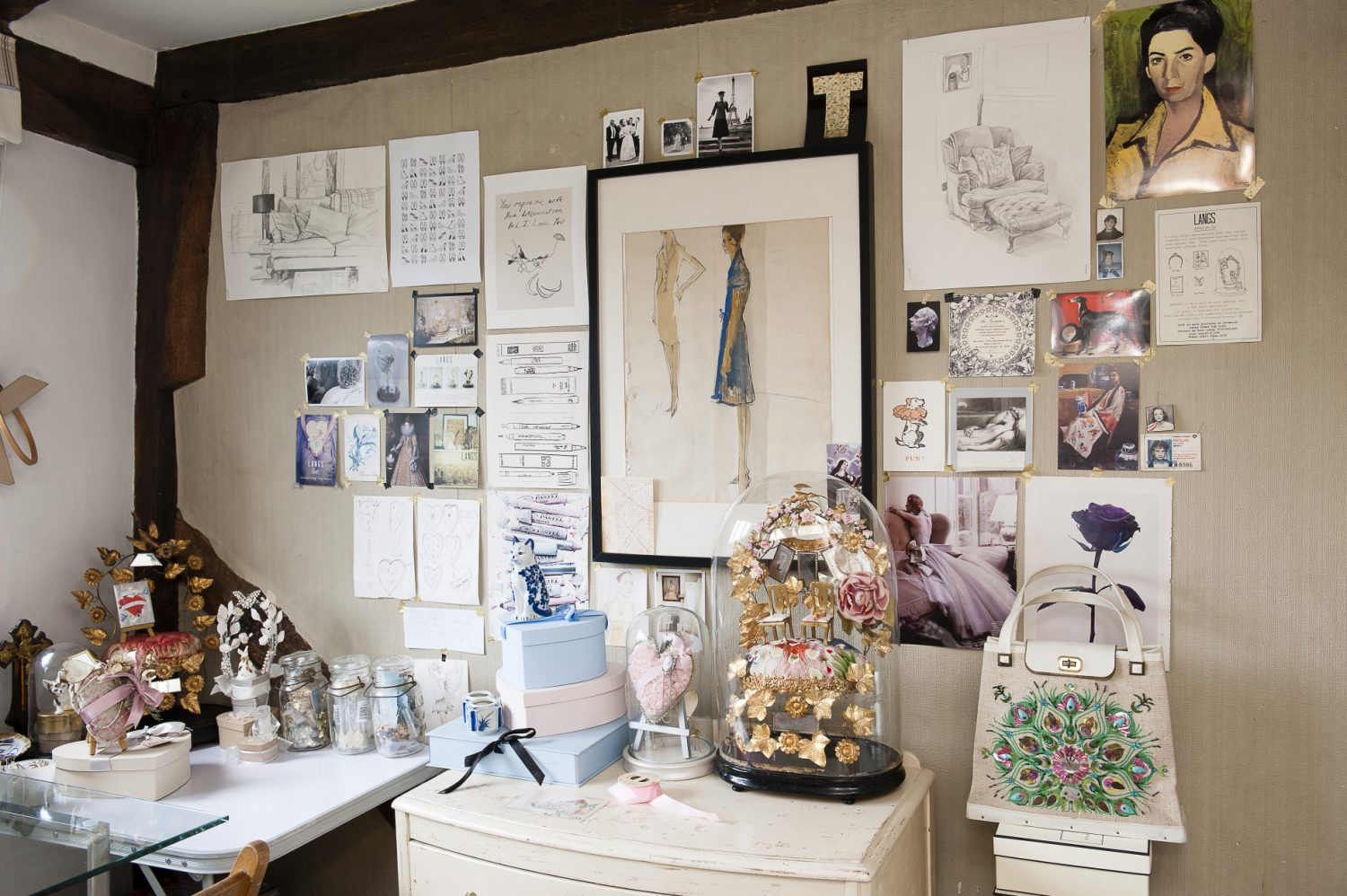 Roni's studio is a treasure trove of items for future domes. She cleverly reuses her old Jo Malone boxes as a way of keeping her trimmings, keepsakes and mementoes in order. Every available inch of wallspace is covered by clippings from magazines, drawings and paintings by herself and friends