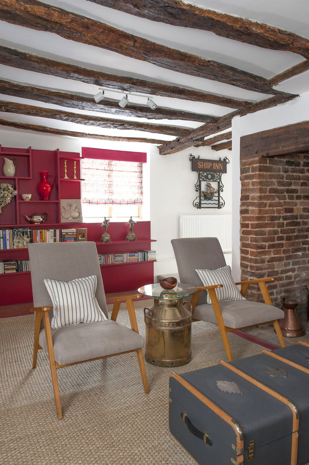 The sitting room has a large inglenook fireplace