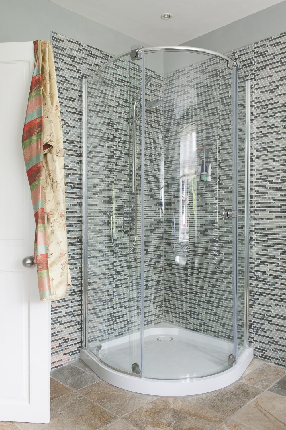 """""""When we moved here it was a bedroom, but we wanted a large light room with both a bath and a shower and it was the perfect space for that,"""" says Jane"""