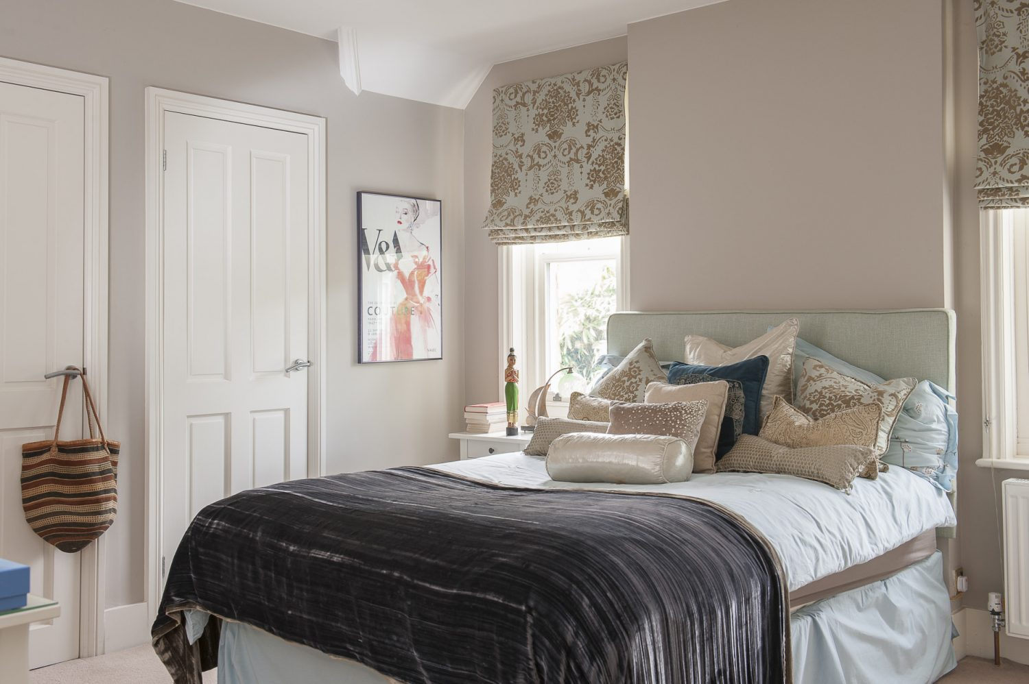 Daughter Emma fancied a touch of baroque in her bedroom, which Jane created by combining pale blue, rich browns and delicate golds in a range of texured fabrics for dressing the bed
